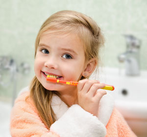 Pediatric Dentist - Brushing Teeth