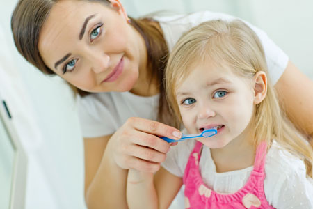 Mom and Daughter brushing their teeth - Pediatric Dentist in Pompton Lakes, NJ
